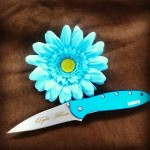 Capture your sweetheart with this Teal Kershaw Leek, nothing says it better than flowers and a knife with MeaCulpa font