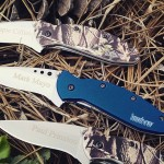 Kershaw Scallion Knives 1620. Camo and navy blue colored aluminum handles with custom engraving. These were done for one of our special customers.