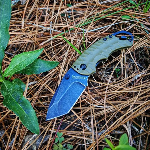 Kershaw Shuffle II Olive Black Wash Tanto Knife 8750TOLBW. This knife is very unique with its textured handle, black wash blade, and bottle opener! Another fun fact, the blade on the shuffle II is has a longer blade than the Shuffle I. Get yours today at Kerahw-knives.net ! #kershaw #shuffle #II #tanto #tip